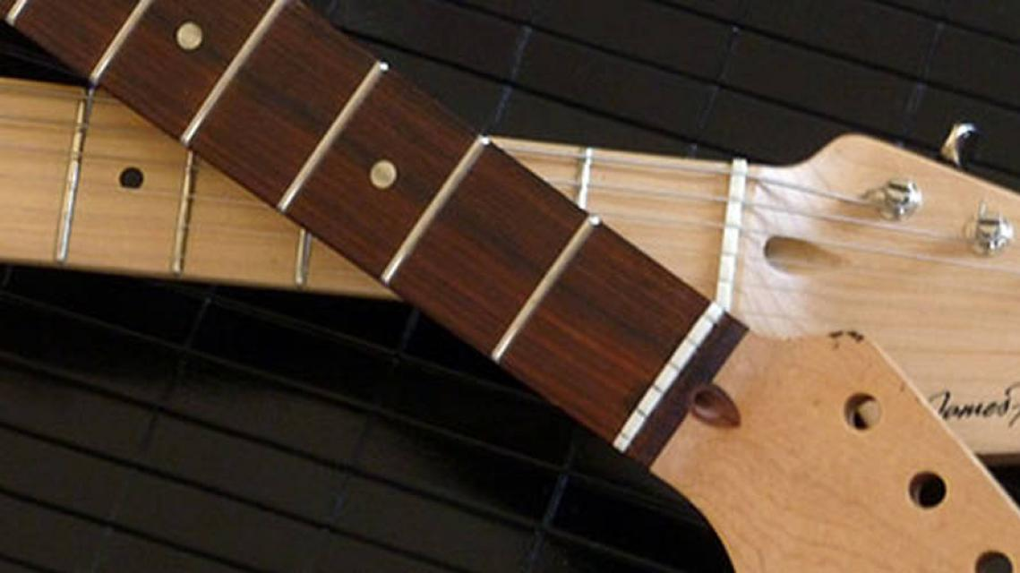 two guitar necks with maple and rosewood fingerboards
