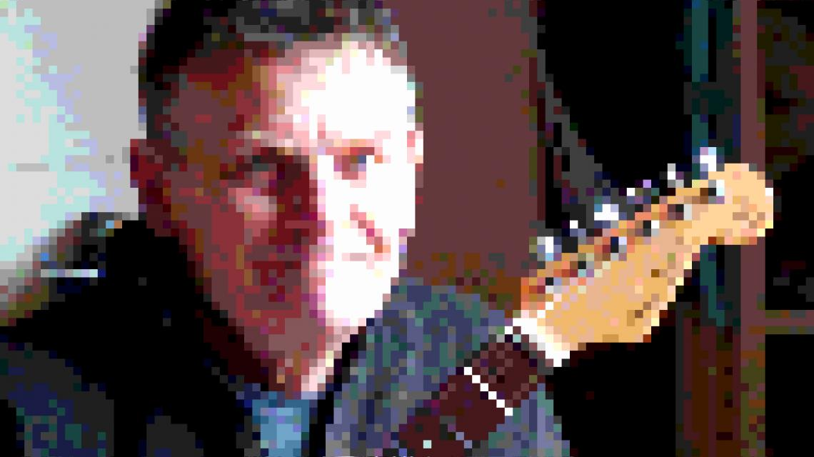 Heavily pixelated picture of James Bissset's face and a guitar head