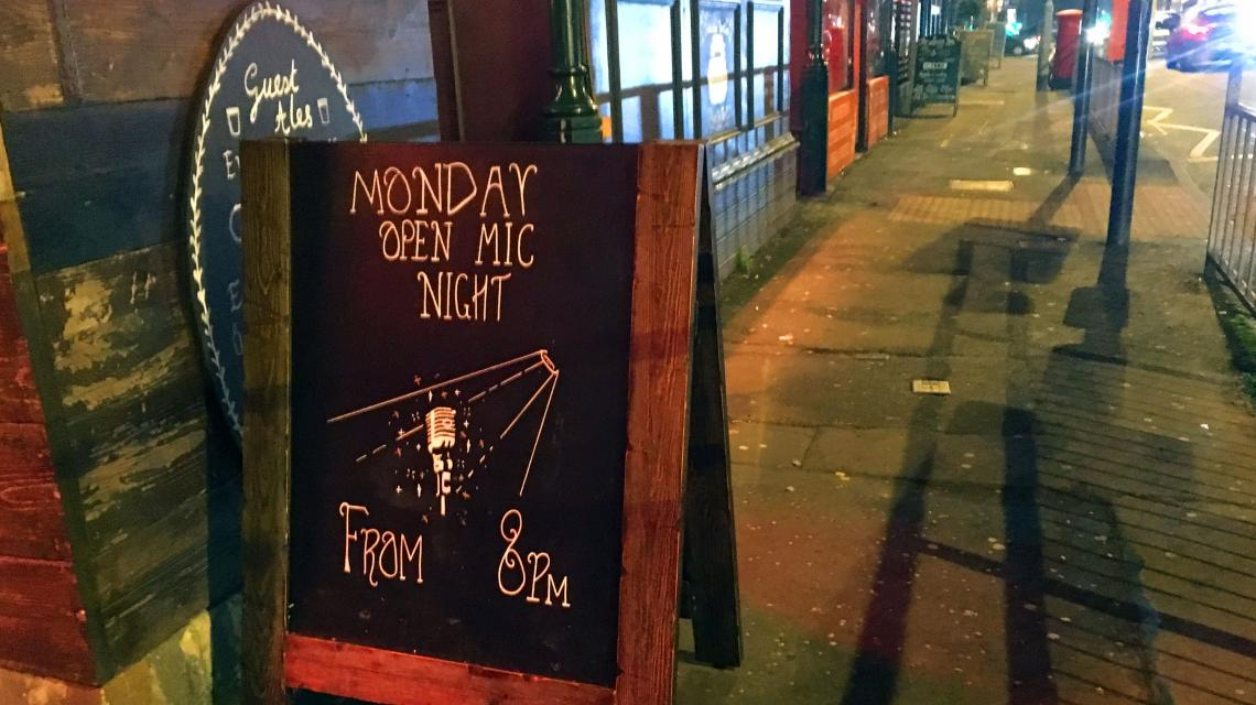 Sandwich Board outside pub announces 'Open Mic Night'