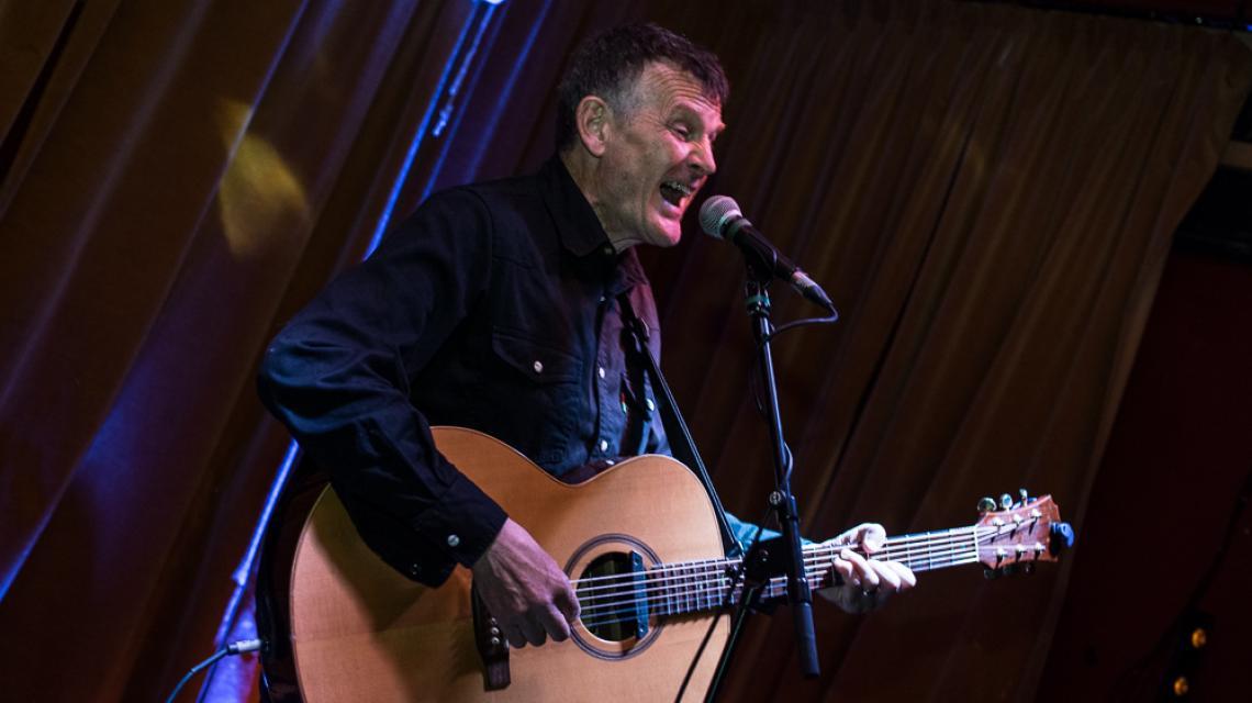 James Bisset singing on stage at Gullivers NQ